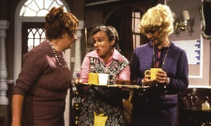 Julie Walters, centre, as Mrs Overall in the spoof soap Acorn Antiques, written by Victoria Wood, left, and also starring Celia Imrie, right.