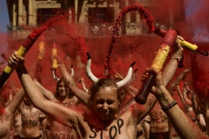 Demonstrators break banderillas – the decorated barbed sticks used in bullfighting – and shower themselves with red dust