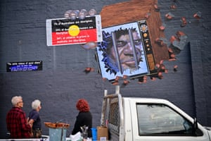 Sydney: Artist Tim Guider works on a mural titled The Subtle Violence of Social Silence, highlighting indigenous Australian deaths in custody