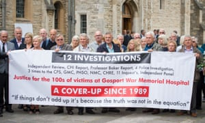 Family members of people who died at Gosport War Memorial hospital hold up a protest banner