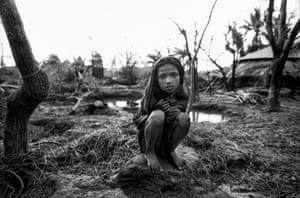 Anwara, Chittagong, Bangladesh, 1991: a girl stands near the remains of her home in Anwara, in the aftermath of a deadly storm