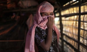 A Rohingya woman in Kutupalong refugee camp, Bangladesh, covers her face with a headscarf