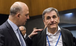 European economics commissioner, Pierre Moscovici, left, speaks with the Greek finance minister, Euclid Tsakalotos, at the Eurogroup meeting.