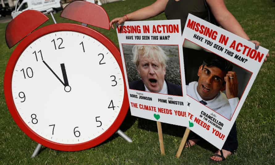 'At this vital moment, Boris Johnson is missing in action. When the issues at stake are so large it's irresponsible fo rthe response to be so small.' A Climate Coalition protest in London 100 days ahead of the Cop26 summit