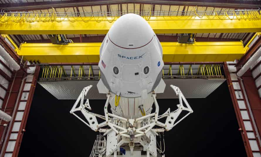 The Crew Dragon spacecraft and the SpaceX Falcon 9 rocket are seen on 21 May at Nasa's Kennedy Space Center in Florida.