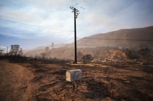 A mailbox stands in an area blackened by the Lake Fire in Lake Hughes.