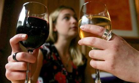 Women drinking glasses of wine.