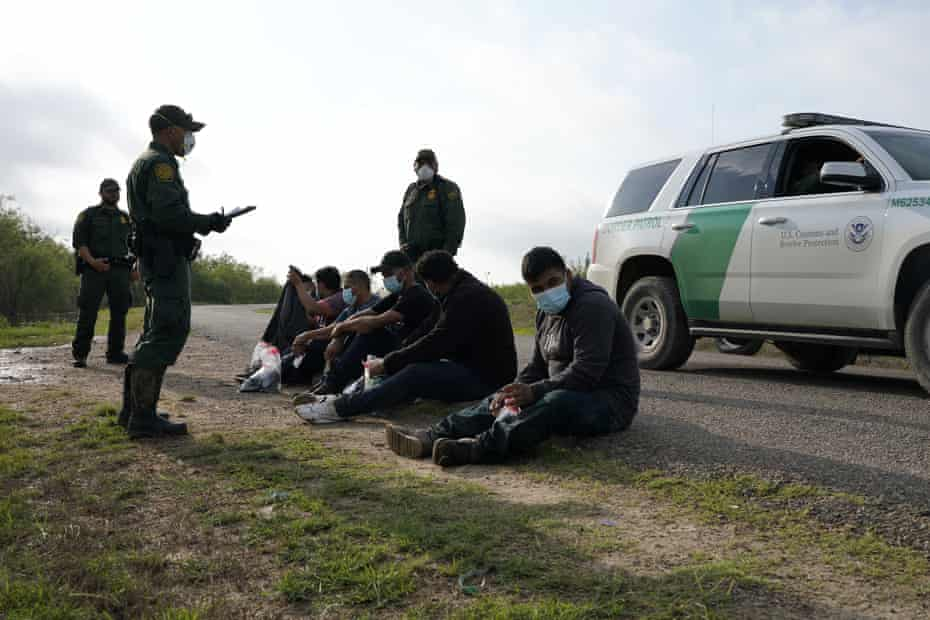 Undocumented migrants are detained by US border patrol agents in La Joya, Texas, May 2021.