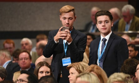Young men in matching suits.