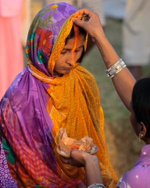 A local Indian woman is blessed at a prayer ritual at Chhath Puja, a Hindu festival, in Dharnia Village.