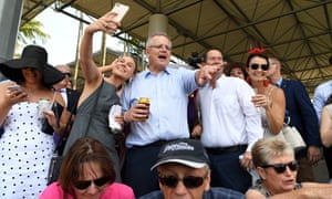 Scott Morrison looks at the Melbourne Cup main event at the Corbould Park on the sunshine on Tuesday