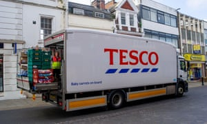 A Tesco lorry driver offloads a delivery in Windsor. Companies are reporting a shortage of HGV drivers following Brexit and the Covid-19 pandemic Covid-19 lockdown lifting.