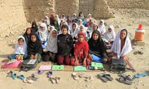Teacher Mahajera Armani and her class of girls at their open-study area