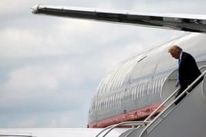 Donald Trump leaves his plane.