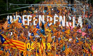 People waving Catalan flags during a pro-independence demonstration in Barcelona on Catalonia's national day on 11 September 2018.