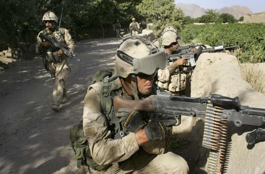 Canadian army forces take positions during a sweep for Taliban fighters June 14, 2006 in Panjwai.