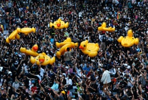 Protesters carry ducks at a demonstration at Ratchaprasong intersection