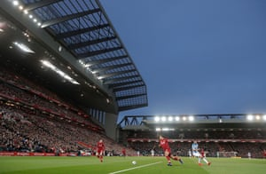 Virgil Van Dijk clears the ball during the Liverpool v Huddersfield Premier League match at Anfield in April 2019.