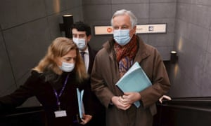 Michel Barnier (right) coming out of a metro station on his way to a meeting in Brussels earlier.