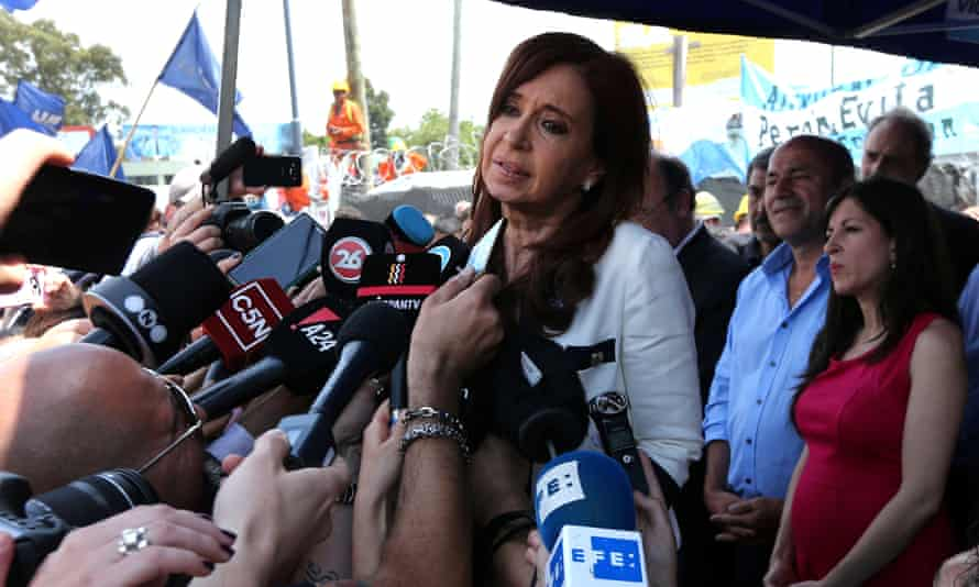 Cristina Fernández de Kirchner speaks to journalists after leaving court in Buenos Aires.