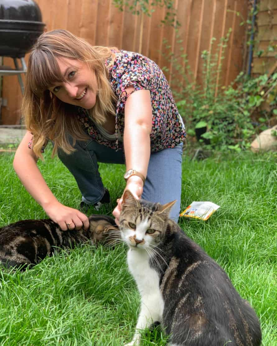 Rebecca Goodman at home with her cats Oscar and Dennis