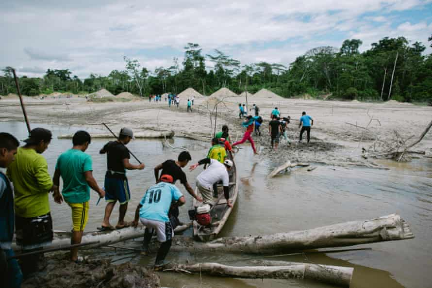 A site of illegal mining is invaded by protesters