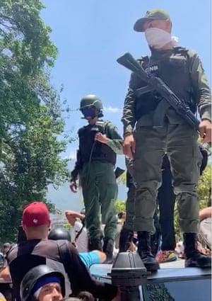 National Guard in Venezuela stand with defectors in Plaza Altamira