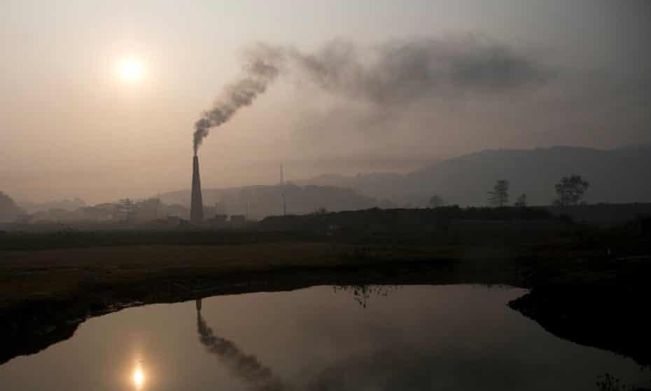 Smoke rises from a brick kiln