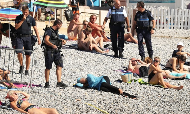 French police approach woman in burkini on beach
