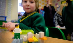 Children play with lego in a maths class