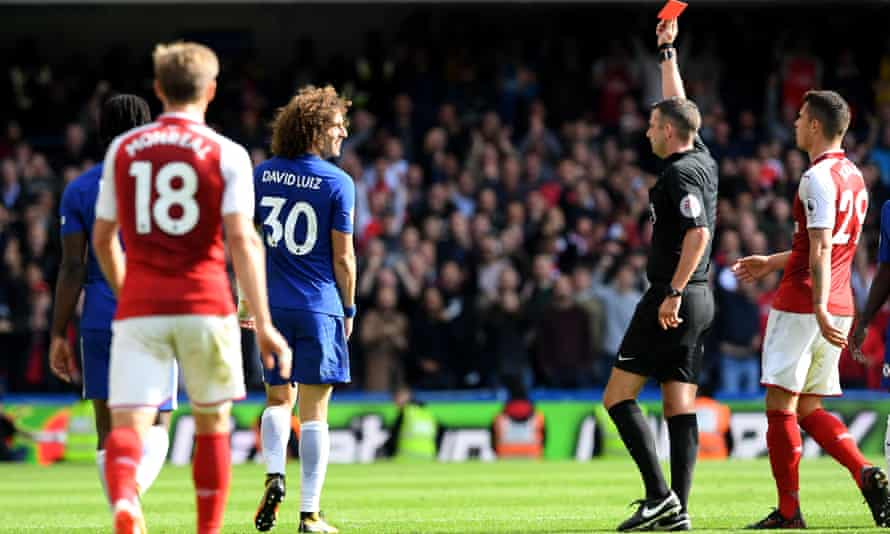 Chelsea's David Luiz is sent off by referee Michael Oliver after a foul on Sead Kolasinac.