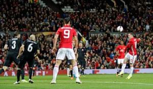 Wayne Rooney scuffs his shot.