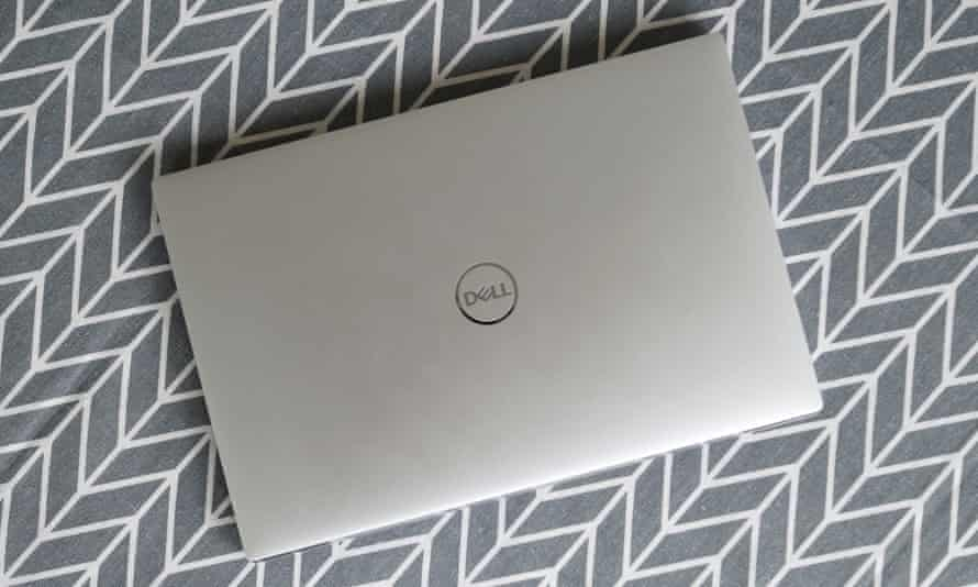 The lid is smooth aluminium with a chromed Dell logo in the centre