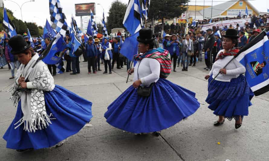 Supporters of President Evo Morales perform at a closing campaign rally in El Alto, on the outskirts of La Paz, Bolivia, Wednesday.