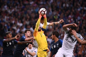 Hugo Lloris catches the ball under pressure.