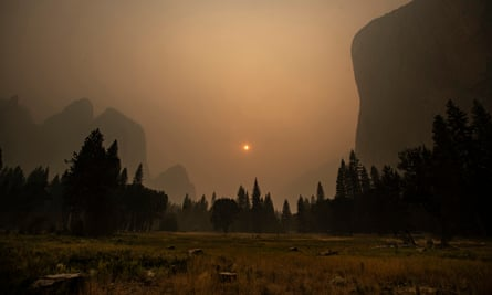 Thick smoke from multiple forest fires shrouds the El Capitan rock formation, right, in Yosemite national park on 12 September.