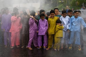 Boys are doused with water prior to a mass circumcision ceremony at the Bandar Tun Hussein Onn mosque