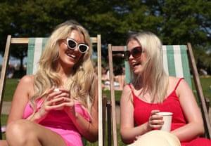 Grainne Gallanagh (left) and Ruth Chalke sunbathing in Hyde Park, London.