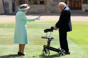 The Queen awards Captain Tom Moore with the insignia of Knight Bachelor at Windsor Castle
