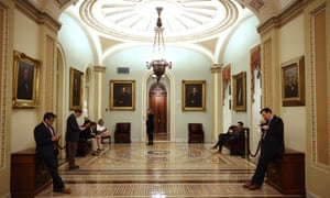 Reporters wait in the hallway outside of the Senate chamber during negotiations Tuesday night.