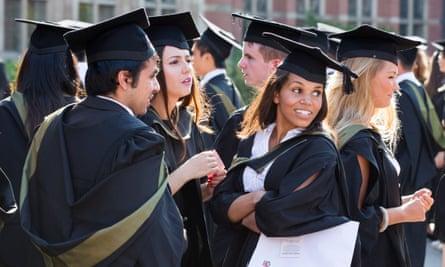 Graduates from Birmingham University mingle after the graduation ceremony.