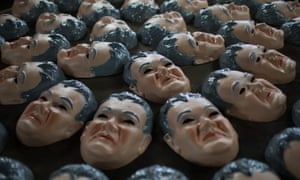 Carnival masks in likeness of Newton Ishii.