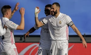 Real Madrid's Karim Benzema (right) celebrates after scoring the opening goal.