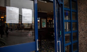 A sign on a JD Wetherspoon pub in Birmingham stating that to improve ventilation the doors will remain open.