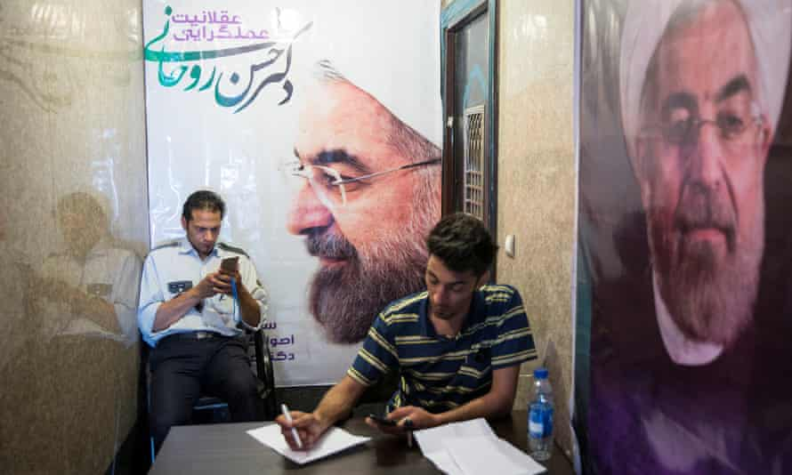 Posters of Iran's incumbent president Hassan Rouhani are plastered around Tehran.