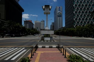 An almost empty intersection on Jalan M.H. Thamrin, one of the main roads in Jakarta, Indonesia