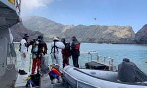 Police divers prepare to search the waters near White Island, New Zealand, on Saturday. A team of defence force operatives who returned to search on Sunday came back empty-handed.