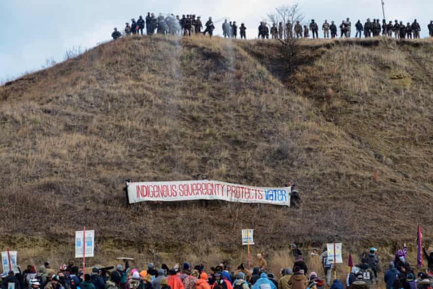 Activists raise a banner during a protest against the Dakota Access pipeline in November.