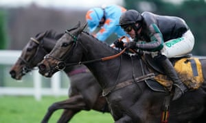 Altior, ridden by Nico de Boinville (foreground) takes on Un De Sceaux to win the Tingle Creek Chase at Sandown.