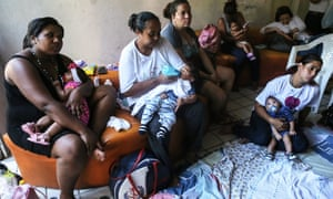 Infants born with microcephaly are held by mothers and family members at a meeting for mothers of children with special needs in Recife, Brazil.